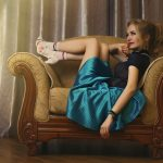 girl sitting on antique sofa