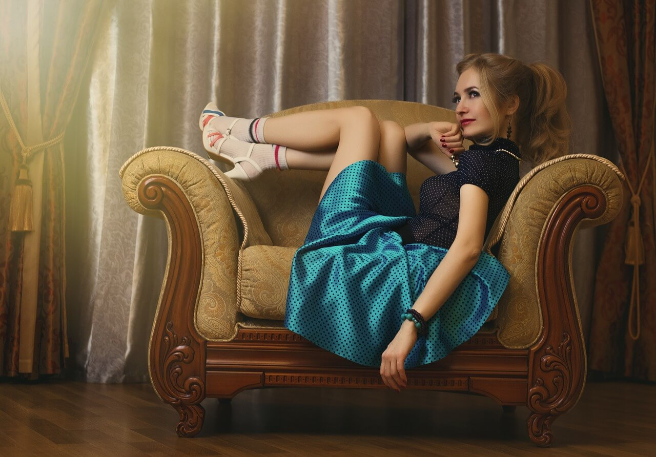 girl sitting on antique sofa
