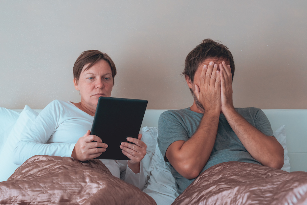 Bored couple, husband and wife in bedroom