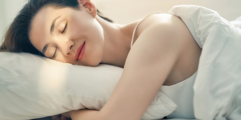 beautiful young woman is sleeping in the bedroom